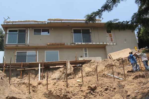 Damaged slope puts Los Angeles hillside home at risk of sliding off the hillside